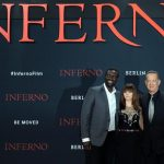 epa05580049 (L-R) French actor Omar Sy, British actress Felicity Jones and US actor Tom Hanks pose for the photographers as they arrive for the Germany premiere of the movie 'Inferno' at a cinema in Berlin, Germany, 10 October 2016 evening. The countrywide launch of the thriller movie in Germany will be on 13 October 2016.  EPA/BRITTA PEDERSEN